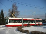 Inekon Tram on the snowy Street in Ostrava